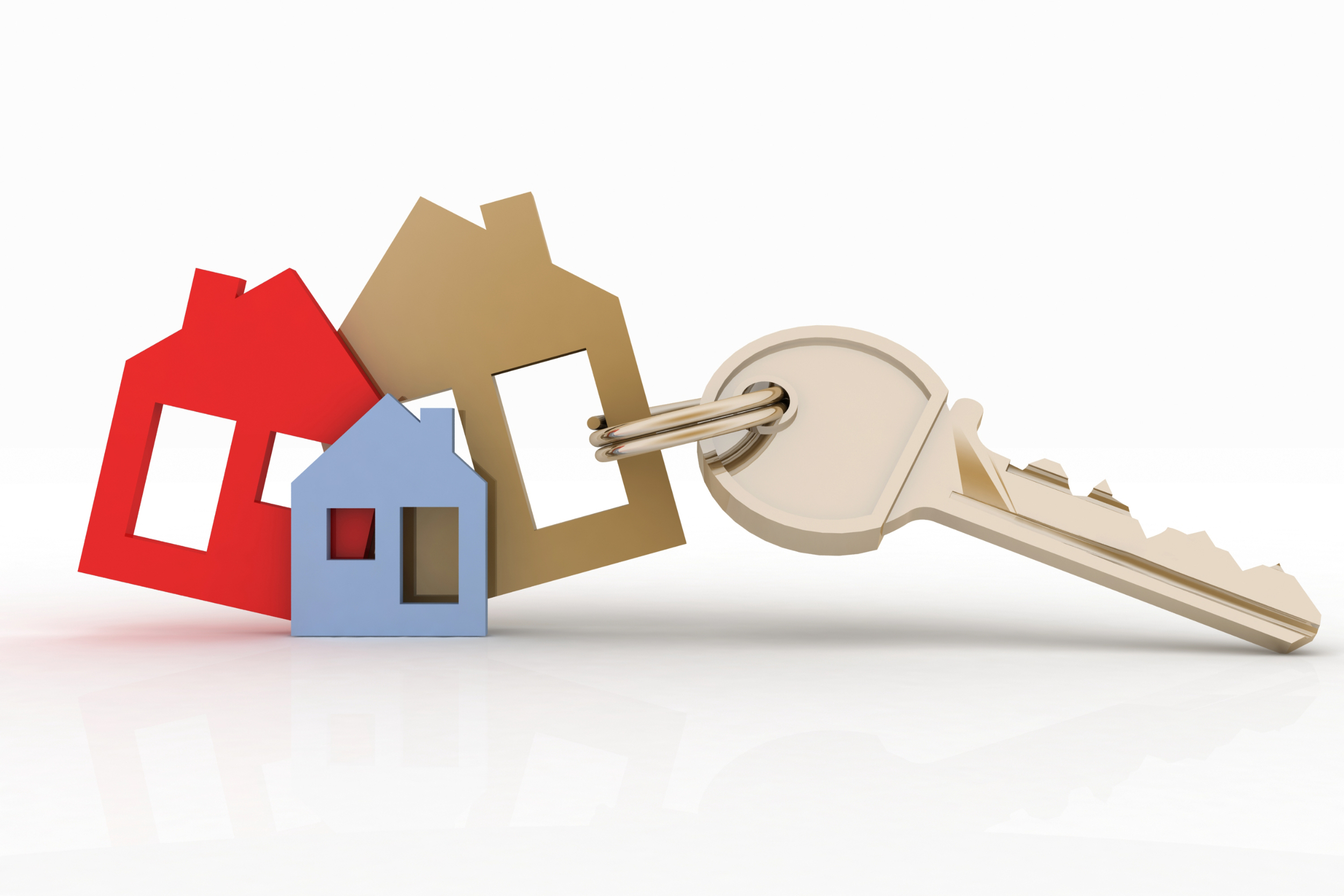 House keys with a colorful keychain on a white background