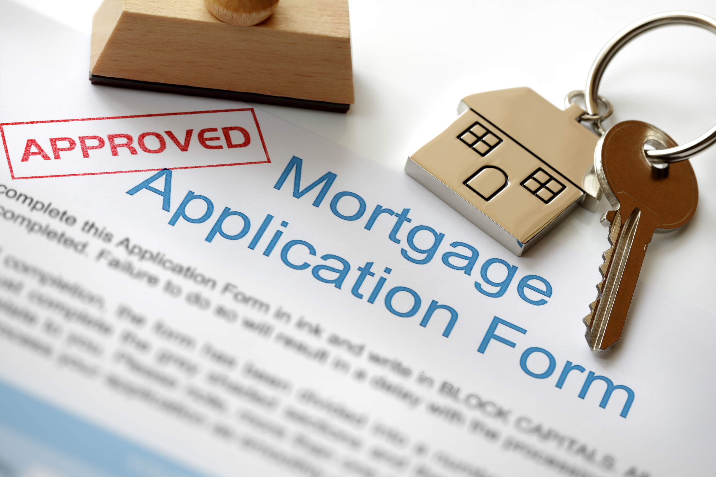 Approved mortgage application with keys