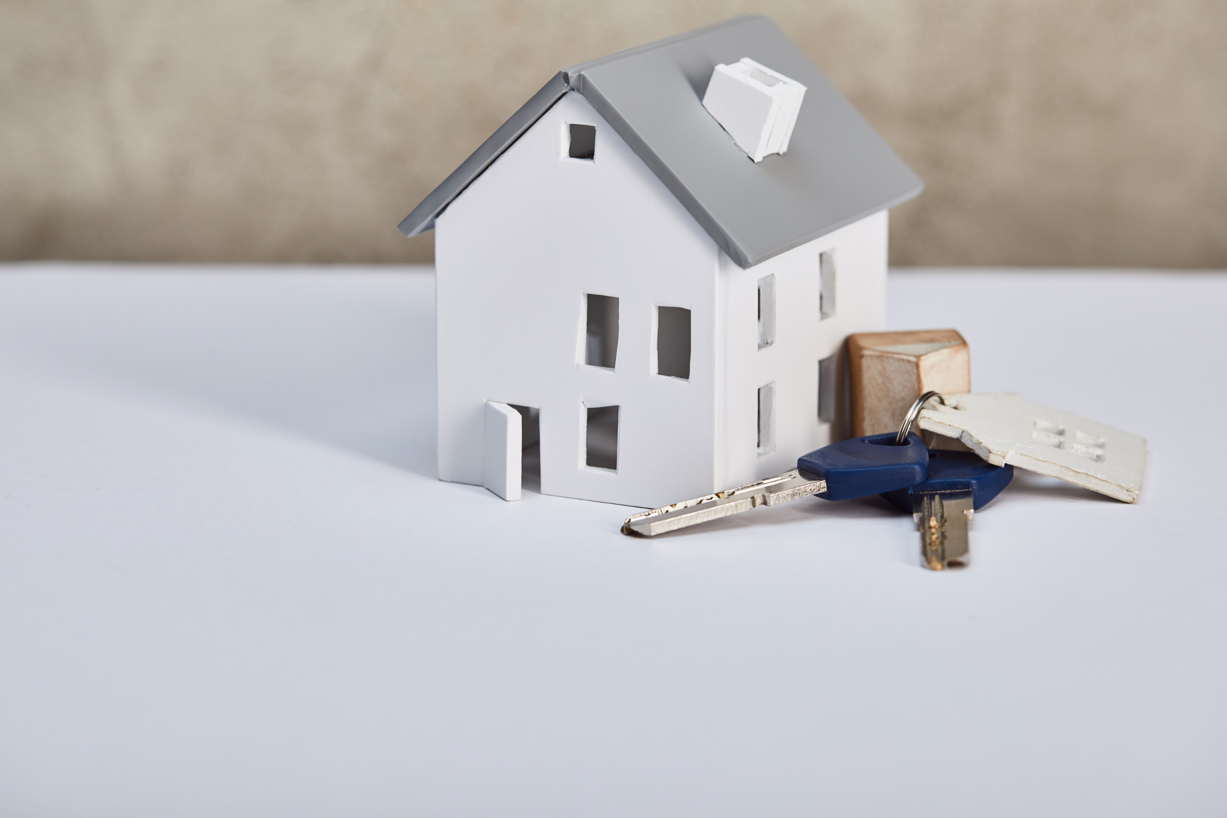 Model home with house keys